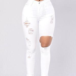 white glistening distressed skinny jeans